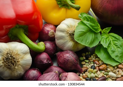 Assorted vegetables and dry beans: onions, bell peppers, garlic, basil leaf, legumes