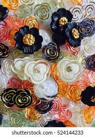 Assorted Vintage flower buttons, crafts background
