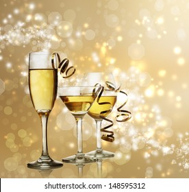 Assorted Wine, Champagne and Coctail Glasses on a Sparkling Gold  Backdrop