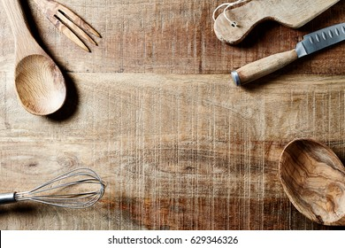 Assorted wooden kitchen utensils on a rustic wooden surface. flatlay. Copy space