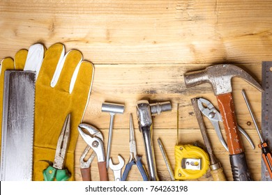 Assorted work tools on wooden board - DIY concept