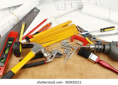 Assorted work tools and plans