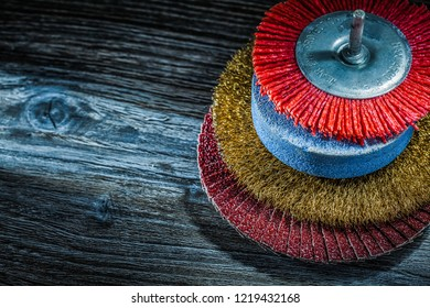 Assortment of abrasive tools on vintage wooden board.