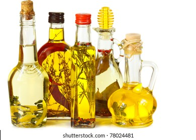 Assortment aromatic olive oil with herbs and spices.