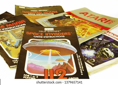 Assortment of Atari 2600 game manuals circa 1981 on white background. Illustrative editorial use only.