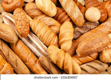 Assortment of baked bread on table background