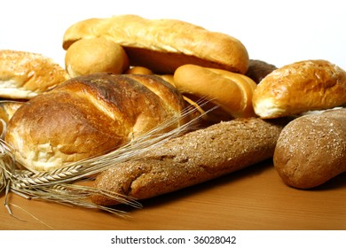 Assortment of baked bread on wood table.