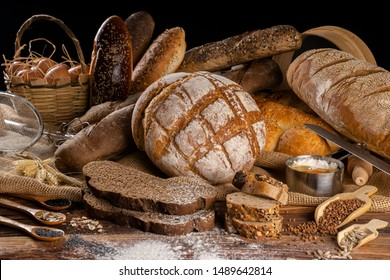 Assortment of baked bread on wooden table background - Shutterstock ID 1489642814