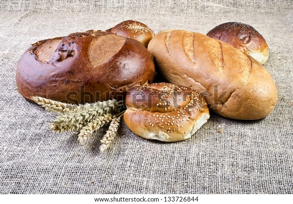 Assortment of baked goods close-up, lying on sacking