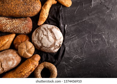 Assortment of baked goods on dark table with free copy space for text. Top view, from above, flat lay.