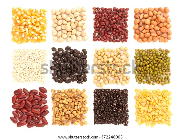 Assortment of beans and lentils  with wood box macadamia isolated on white . mung bean, groundnut, soybean, red kidney bean , black bean ,red bean and brown pinto beans .