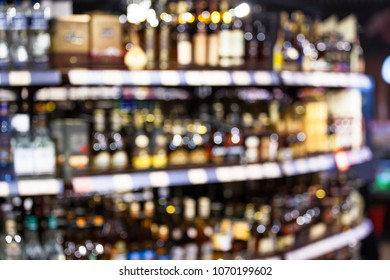 assortment of bottles of wine and alcohol in the store, blurred image