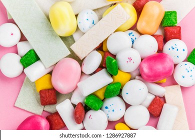 Assortment of bubble gum on pink background on pink backgrouond. Copy space