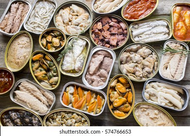 Assortment of cans of canned with different types of fish and seafood,