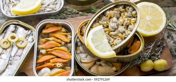 Assortment of cans of canned with different types of fish and seafood