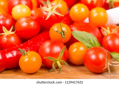 Assortment of cherry tomatoes and peppers freshly picked from the garden