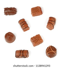 Assortment of chocolate candies isolated on white background. Flat lay, top view.