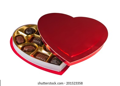 Assortment of chocolates in a heart shaped red box for a Valentine's day gift. Isolated on a white background with a clipping path