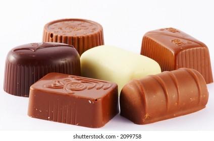 assortment of chocolates isolated on white