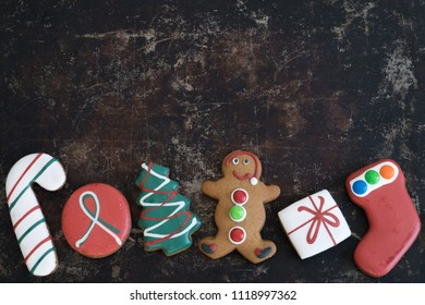 Assortment of Christmas Gingerbread on Tray with Dark Background with Copy Space Top