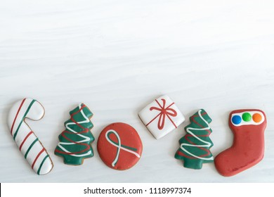 Assortment of Christmas Gingerbread on White Background with Copy Space Top