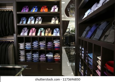 Assortment of classic shirts at menswear store