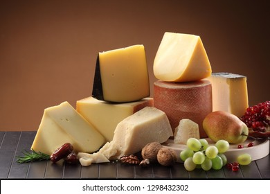 Assortment collection  of Italian, Swiss, English, French and Holland cheeses still life
