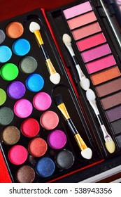 assortment of colored eye shadows for make-up