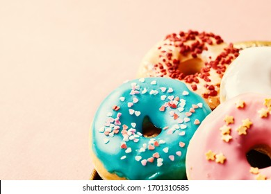 Assortment of colorful glazed donuts, close up