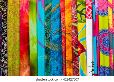 Assortment of colorful sarongs for sale at the art and craft market of Ubud on Bali Island, Indonesia