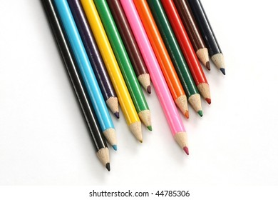 Assortment of coloured pencils isolated on white
