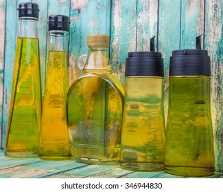 Assortment of cooking oils over wooden background