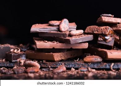 Assortment of dark and milk chocolate stack, truffles.
