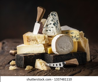 Assortment of different cheese types on wooden background. Cheese background. - Shutterstock ID 1337481110