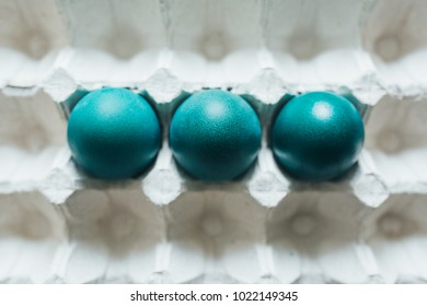 Assortment of different color, fresh, chicken eggs in a gray tray background