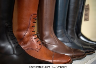 An assortment of different colored horse riding boots for women, handmade from real genuine leather.