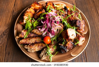 Assortment of different dishes on a plate, grilled meat, barbecue party - shish kebab, lula kebab