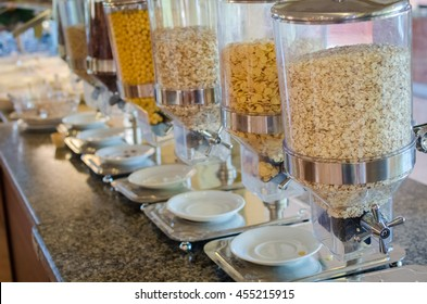 Assortment of different kind of cereals on the table in buffet breakfast in the restaurant. Healthy food.