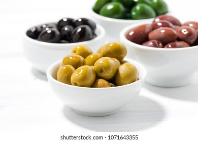assortment of different kinds of organic olives, closeup, horizontal