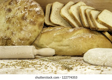 assortment of different type baked bread over brown background