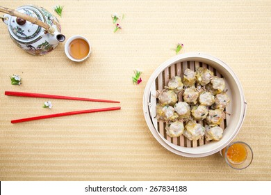 assortment dimsum / Chinese Steamed shrimp dumplings dimsum in bamboo containers traditional cuisine.
