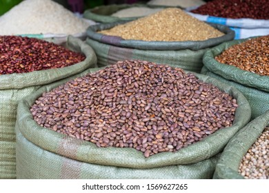 Assortment of dry beans in for sale at a local street food market on the island of Zanzibar, Tanzania, east Africa, close up
