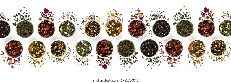 Assortment of dry tea bowls in a row isolated on white background. Panoramic banner. Red, fruit, green, black and herbal leaves dried fresh dessert beverage layout. Flat lay style. Top view concept