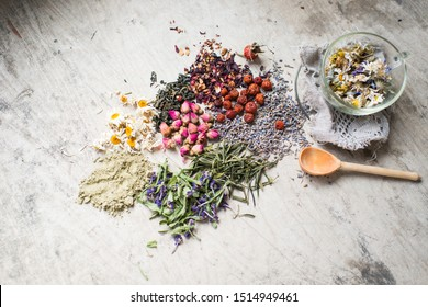 Assortment of dry tea on a wooden background