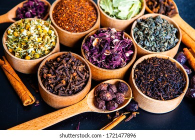Assortment of dry tea. Various kinds of tea composition on black. Different kind of tea leaves.  Different dry herbs and flowers for making healthy hot drink.
