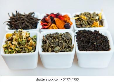 Assortment of dry tea. Various kinds of tea isolated on white.Different kinds of tea leaves. Tea composition with different kind of tea. Tea concept. Tea leaves