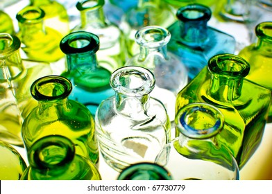 An assortment of empty colorful glass bottles.