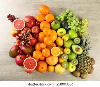 Assortment of exotic fruits on wooden background
