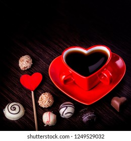Assortment of fine chocolate candies, white, dark and milk chocolate Sweets black background. Space for text