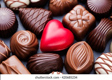 Assortment of fine chocolate candies, white, dark, and milk chocolate Sweets background Copy space Top view